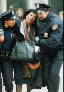 NYPD officers assist woman during 9/11